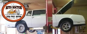 Car on the lift at the Auto Doctor
